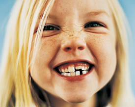 child with milk teeth